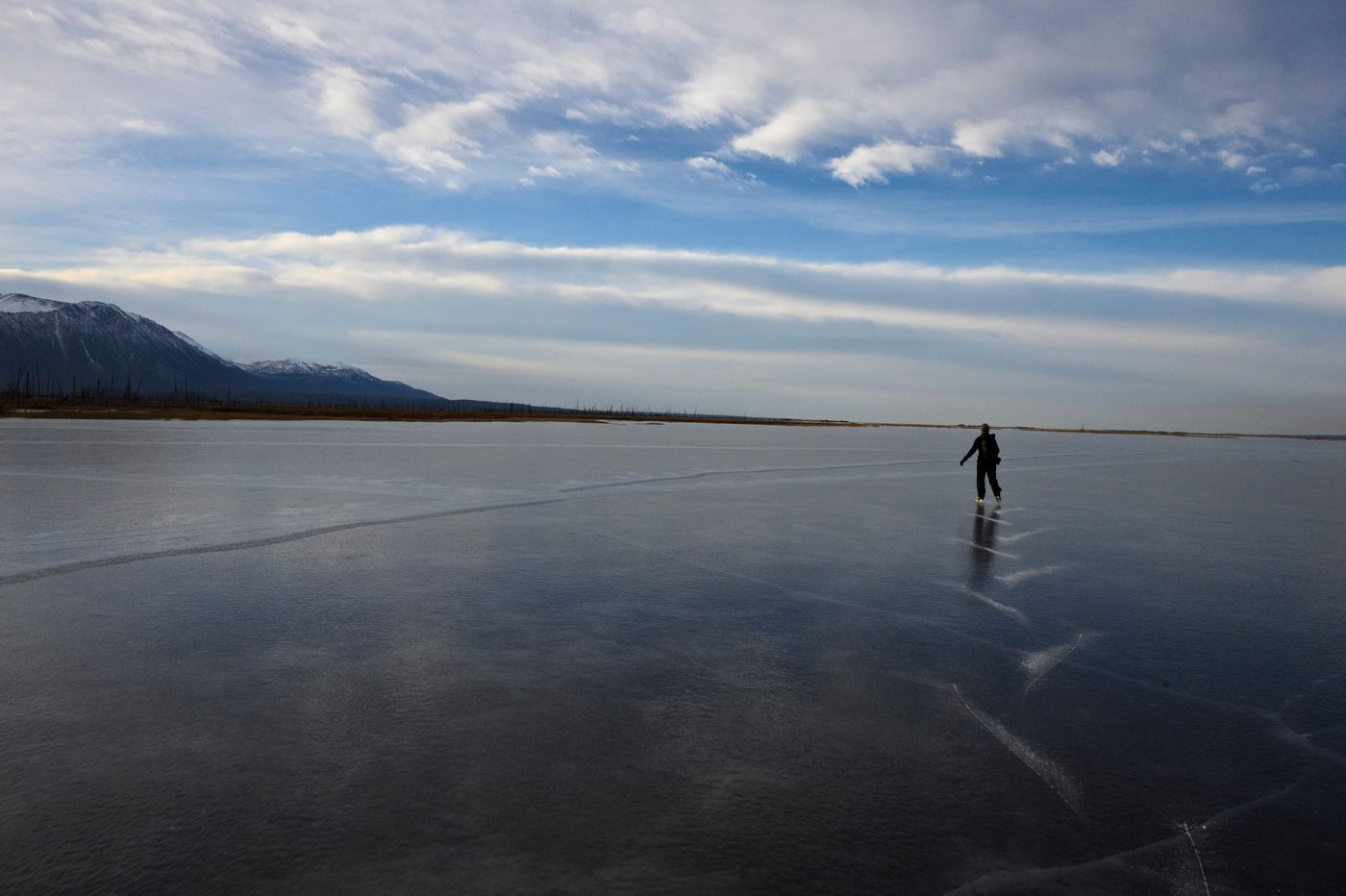 Ashley Saupe, of Anchorage, ice skates on Wasilla Creek and nearby ponds at Palmer Hay Flats State Game Refuge on November 5, 2020. (Marc Lester / ADN)