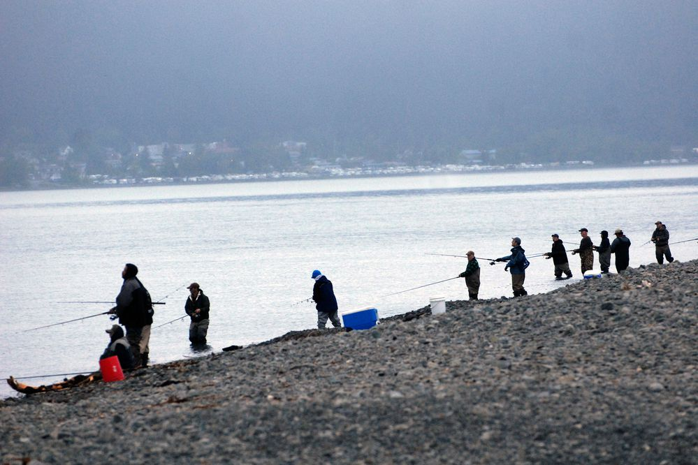 People fish in Resurrection Bay near Spring Creek with the Seward waterfront in the background on Saturday, June 7, 2019. (Matt Tunseth / ADN)