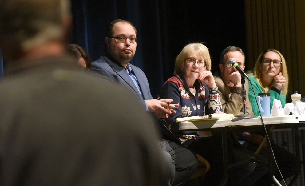 From left, Anchorage Assembly members Felix Rivera, Crystal Kennedy, John Weddleton and Meg Zaletel listen to testimony during a municipal town hall meeting at the Steve Primis Auditorium at Chugiak High School on Wednesday, Jan. 8, 2020. (Matt Tunseth / Chugiak-Eagle River Star)
