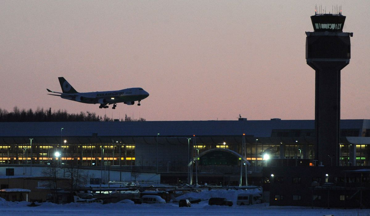 An Eva Air Cargo Boeing 747 Freighter Lands At Ted Stevens Anchorage International Airport After Sunset