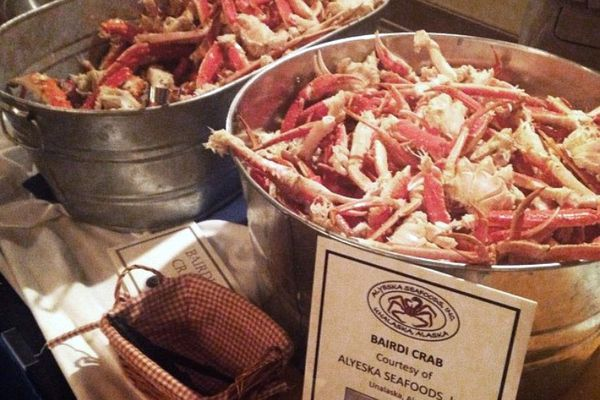 The City of Unalaska shells out crab and other seafood at its annual reception for lawmakers and staff in Juneau, March 17, 2015. (Nathaniel Herz / Alaska Dispatch News)