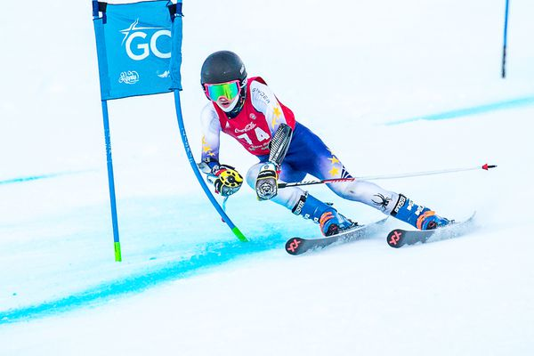 Aggressively bending both this gate and his skis, Alyeska Ski Club's Daniel Ferucci won the U14 class in the first of two giant slaloms in the Coca-Cola Classic series Monday at Alyeska. (Photo by Bob Eastaugh)