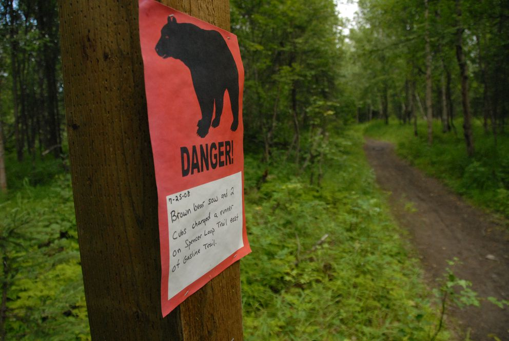 A sign along Rover's Run trail in Far North Bicentennial Parkin August 2008 after a runner was mauled and seriously injured by a grizzly bear on the trail. (Bob Hallinen / ADN archive 2008)
