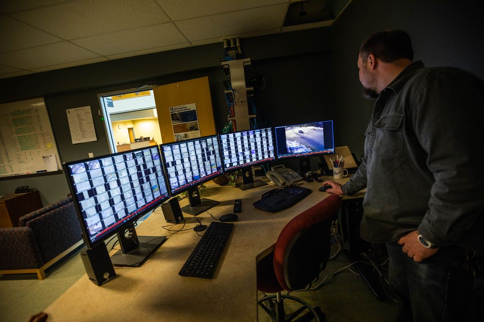 Security specialist Michael Ireland monitors security camera footage from schools at the Anchorage School District education center. The school district can remotely monitormore than 3,000 cameras installed in nearly 100 schools across the district, something the Anchorage Police Department will soon be able to do as well. (Loren Holmes / ADN)