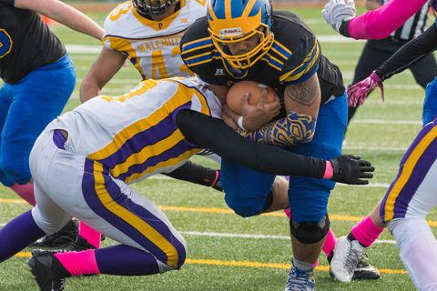 Bartlett's Jontay Edwards is tackled by Lathrop's Jace Henry on Oct. 7, 2017 during a game at Bartlett. (Loren Holmes / Alaska Dispatch News)