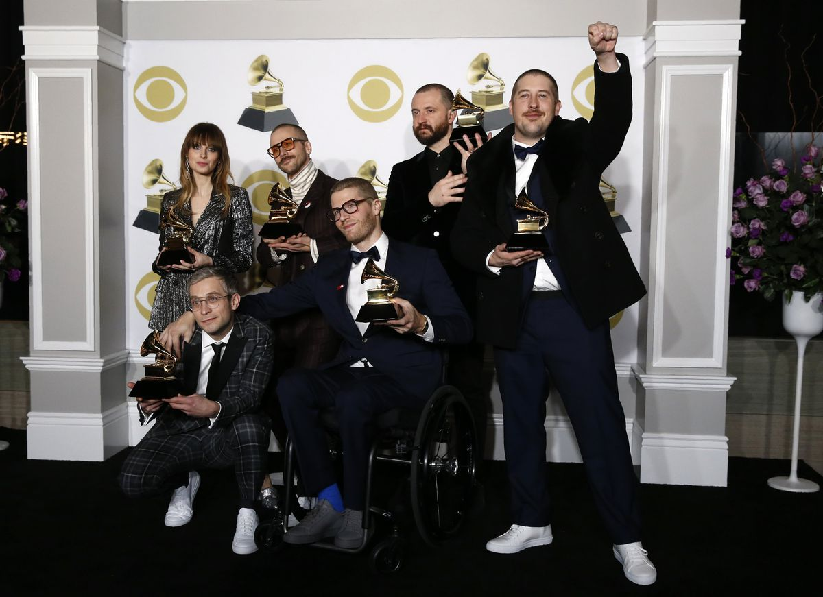 "Portugal. The Man members pose with Grammy trophies for best pop duo/group performance for ""Feel It Still"" after the awards show in late January. REUTERS/Carlo Allegri"