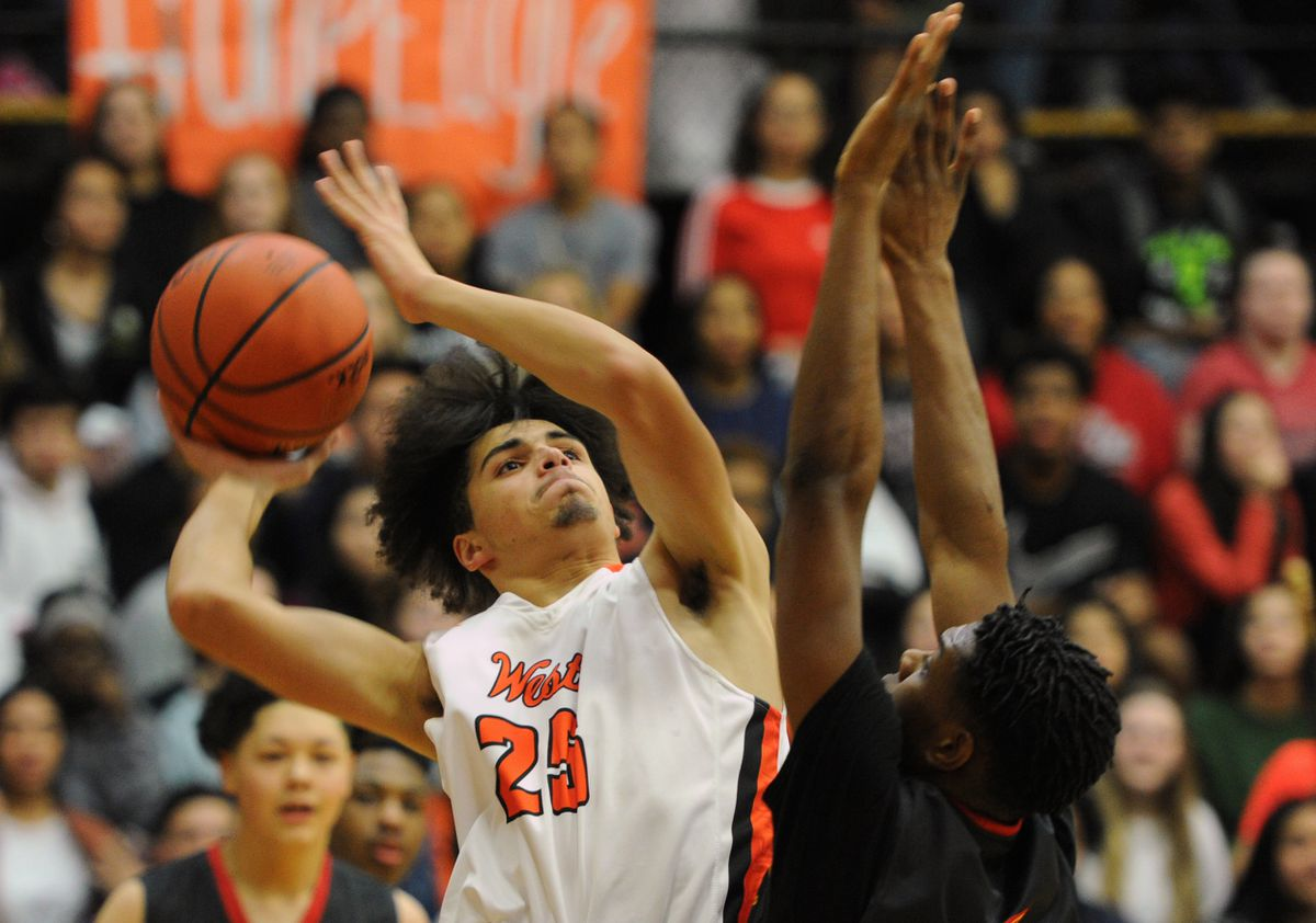 West High senior forward TJ Prater puts up a shot against West Valley defender Chancelor Fields-Colbert during the Wolfpack's 53-51 victory over the Eagles in the Alaska Airlines Classic at West High on Thursday. (Bill Roth / ADN)