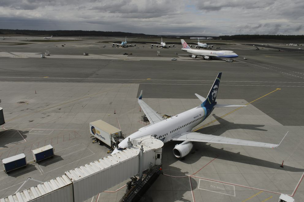 An Alaska Airlines jet is parked a gate at Ted Stevens Anchorage International Airport on May 11, 2020. (Marc Lester / ADN)