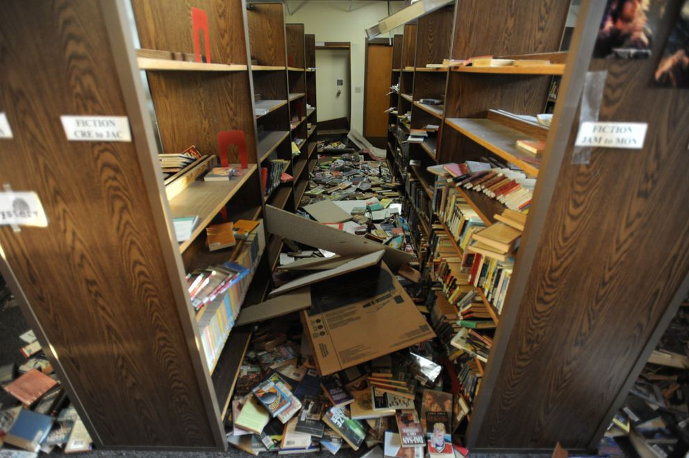 Books were shaken off the shelves in the library at the earthquake damaged Houston Middle School. (Bill Roth / ADN)