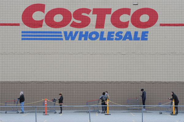 Customers practice social distancing while waiting in line to shop at Costco in South Anchorage on Sunday morning, April 19, 2020. (Bill Roth / ADN)