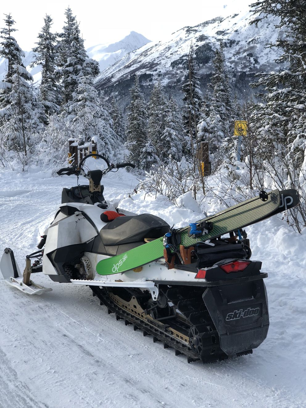 Brett and Rory Marenco mount their skis on snowmachines to access the backcountry. (Courtesy Brett Marenco)