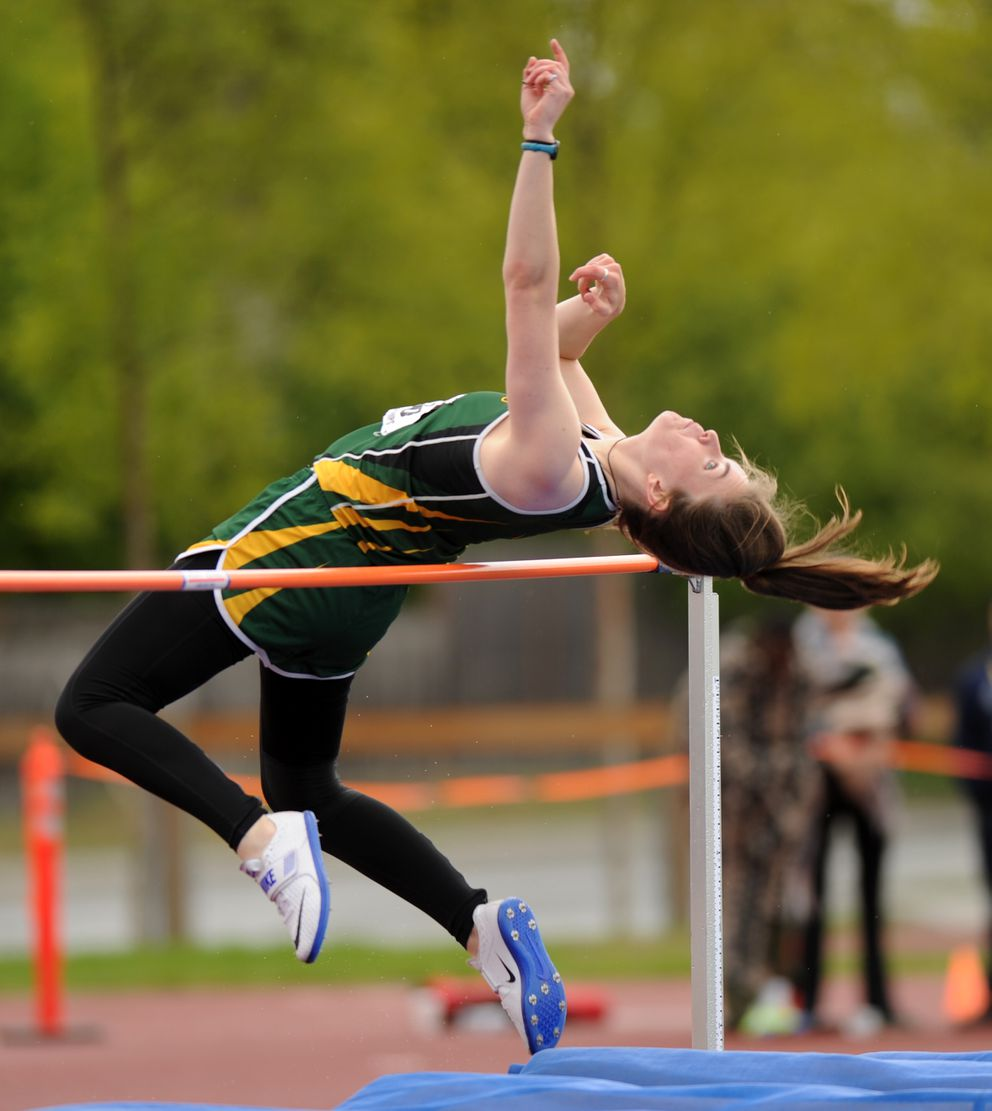 Ann Gebauer of Service leaps to a second-place finish in the girls high jump. (Erik Hill / Alaska Dispatch News)