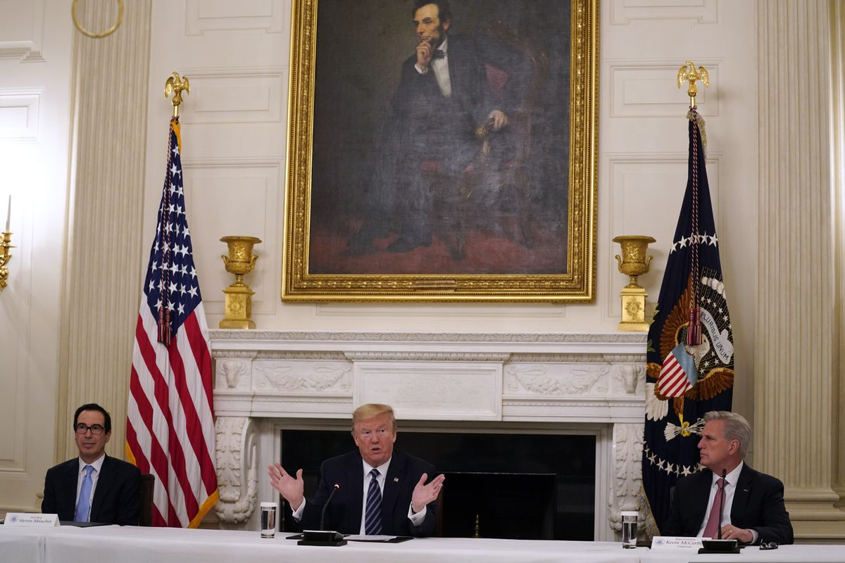 House Minority Leader Kevin McCarthy of Calif., right, and Treasury Secretary Steven Mnuchin, left, listen as President Donald Trump speaks during a meeting with Republican lawmakers, in the State Dining Room of the White House, Friday, May 8, 2020, in Washington. (AP Photo/Evan Vucci)