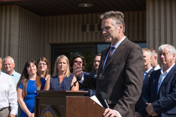 Gov. Mike Dunleavy speaks before signing Senate Bill 2002, which fixes the capital budget and reverse sweep, Thursday, Aug. 8, 2019 at the Associated General Contractors offices in Anchorage. (Loren Holmes / ADN)