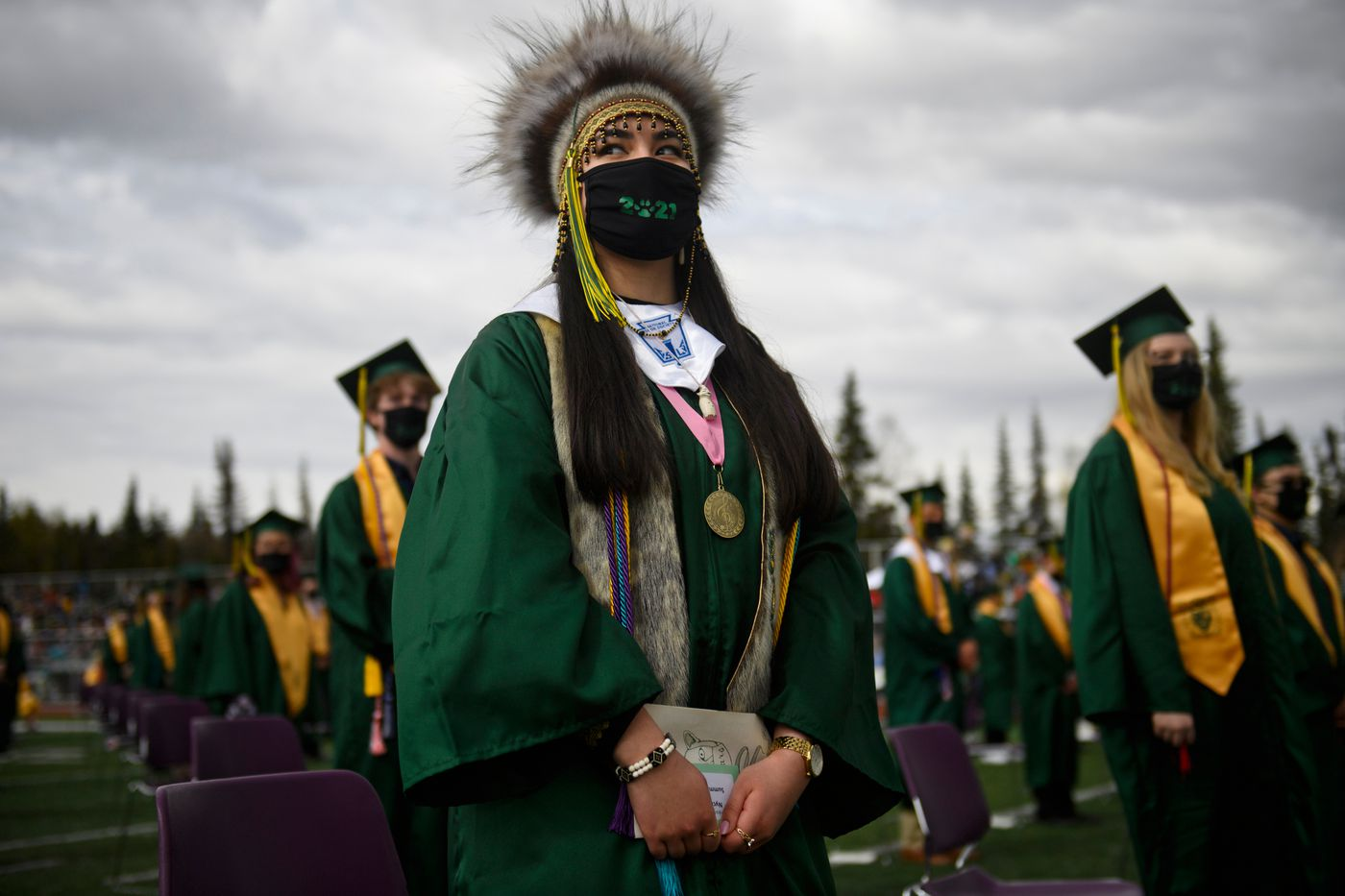 Service High School graduating senior Nyché Andrew worked to change school district's policy to allow for cultural regalia at graduation ceremonies. She wore a Yup'ik headdress, a sealskin sash and mukluks when she graduated on May 12, 2021. (Marc Lester / ADN)
