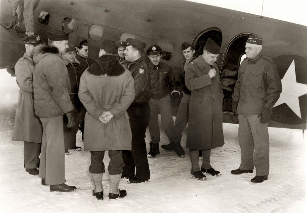 Walter Hodge, second from right, talking to Gen. Simon Bolivar Buckner at an unnamed Alaska location during World War II. The two largest buildings on Prince William Sound were named after these two officers. (Lundin Family Collection / PWS Museum)