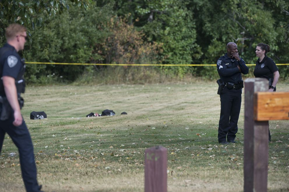 Anchorage Police remain at the scene near 3rd Avenue and Pine street after the incident. Anchorage Police say they shot a man who was pointing a gun at people at Dave Rose Park in Anchorage on August 5, 2019. (Marc Lester / ADN)
