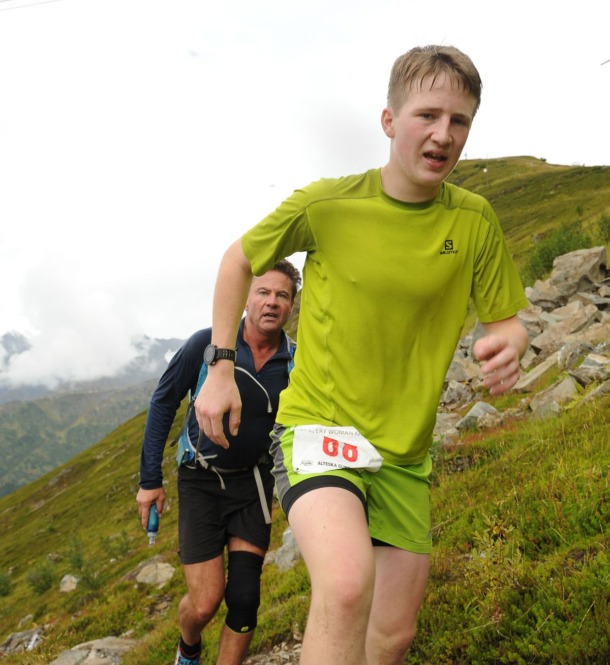 Michael Connelly, 15, leads another runner up the last stretch before reaching the top of the mountain Saturday in the Alyeska Climbathon. (Bob Hallinen / Alaska Dispatch News)