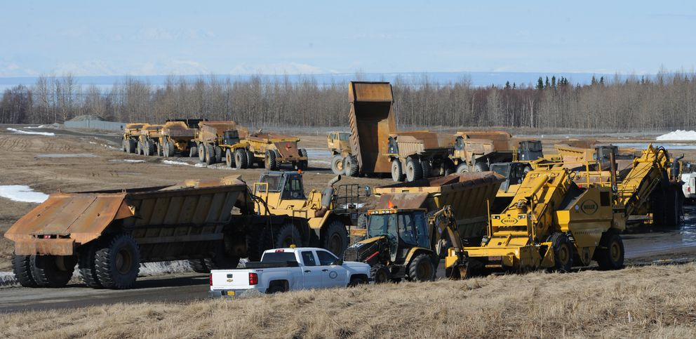 Heavy equipment is staged at Ted Stevens Anchorage International Airport on Thursday, March 28, 2019, in preparation for construction work being done on the north-south runway. (Bill Roth / ADN)