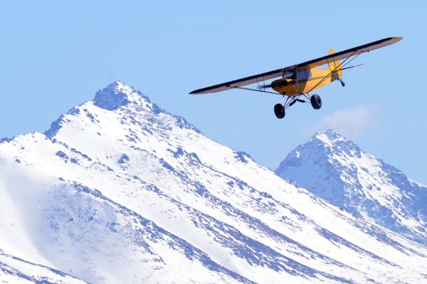 A pilot practices touch-and-go landings on Tuesday afternoon, April 11, 2017, at the gravel airstrip at Lake Hood Seaplane Base. (Erik Hill / Alaska Dispatch News)