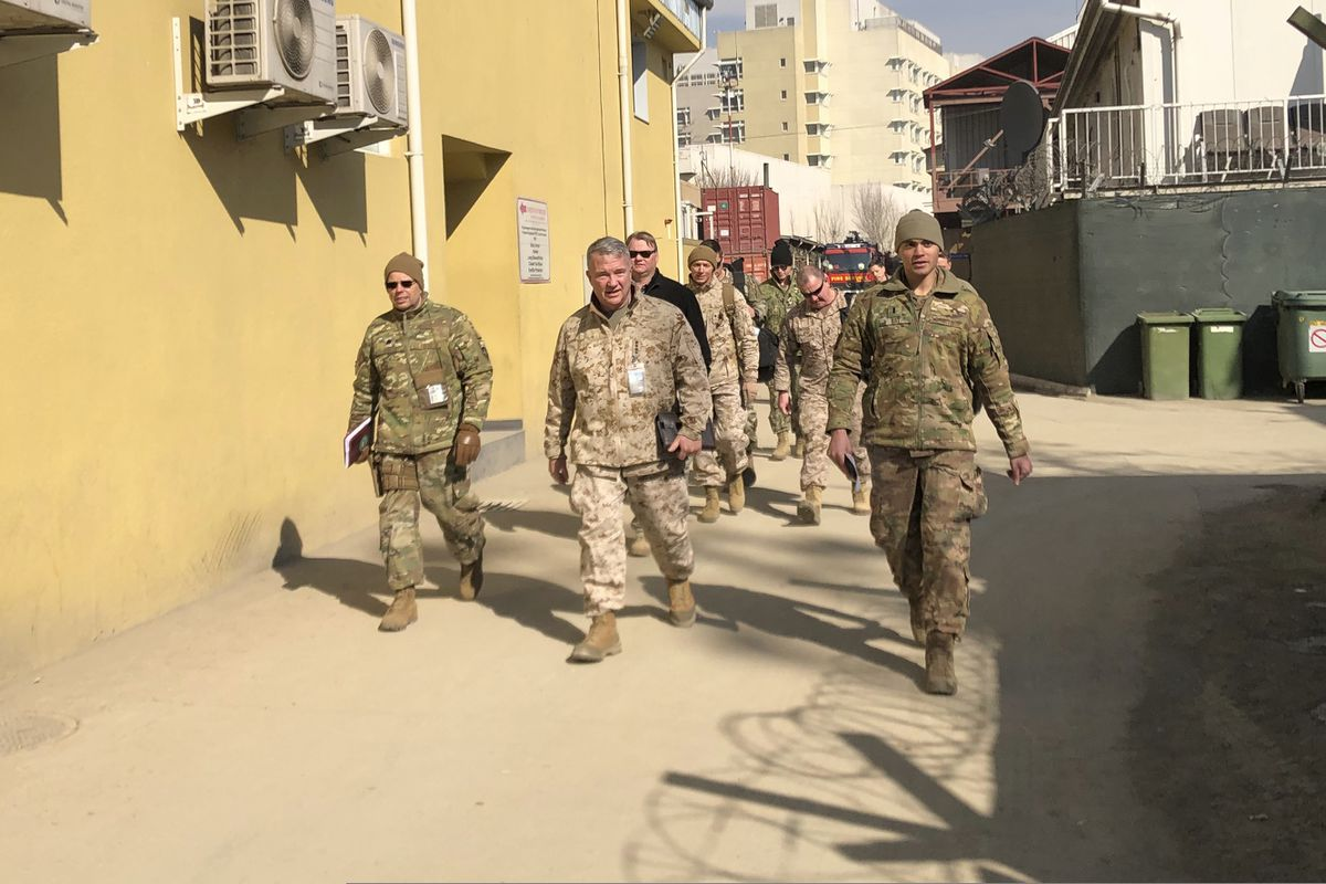 In this Jan. 31, 2020, photo Marine Gen. Frank McKenzie, center, top U.S. commander for the Middle East, makes an unannounced visit in Kabul, Afghanistan. (AP Photos/Lolita Baldor, File)