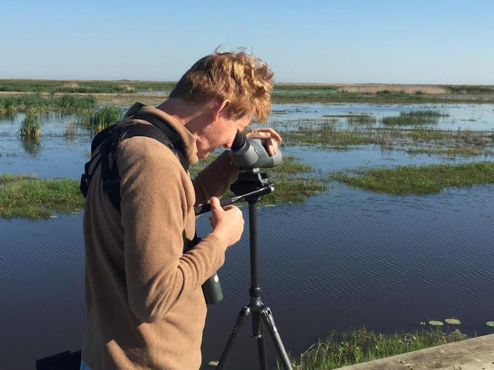 John Weigel looks at birds in coastal Texas in April. (Courtesy of John Weigel via The Washington Post)