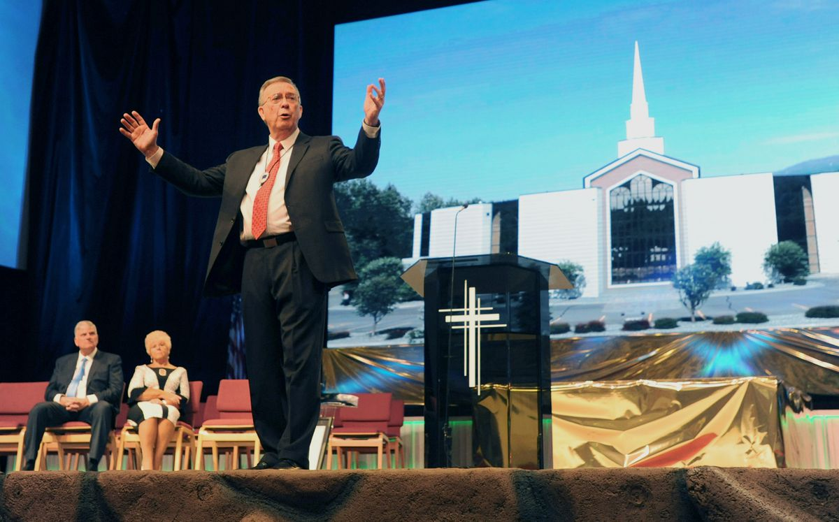 Rev. Jerry Prevo, 74, gives a sermon before retiring as pastor of the Anchorage Baptist Temple after more than 47 years of service on Sunday, May 5, 2019. Pastor Franklin Graham and Carol Prevo are seated at left. (Bill Roth / ADN)