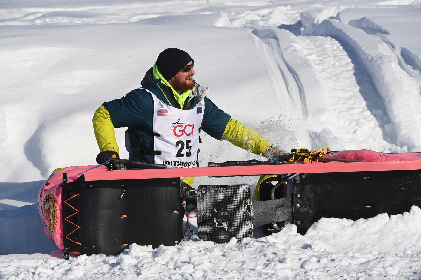 Wade Marrs looks up after rolling his sled at a sharp corner on Susitna River. (Bill Roth / ADN)