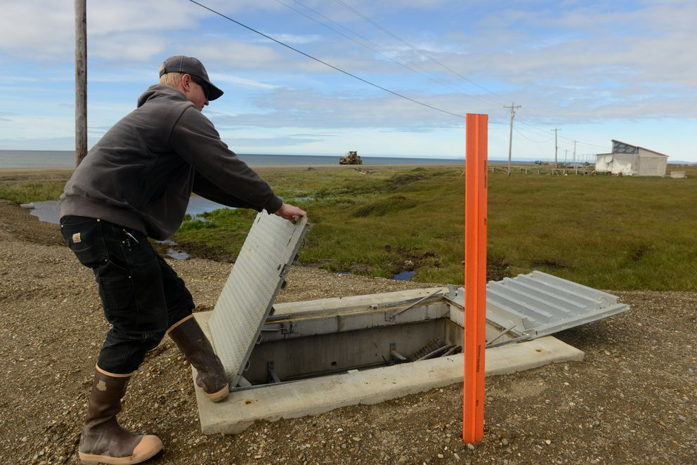 Danny Ashe of New Horizons Telecom opens the vault where the connection of the armored fiber-optic cable coming out of the Bering Sea makes landfall near Nome on Aug. 22, 2016. (Bob Hallinen / Alaska Dispatch News)