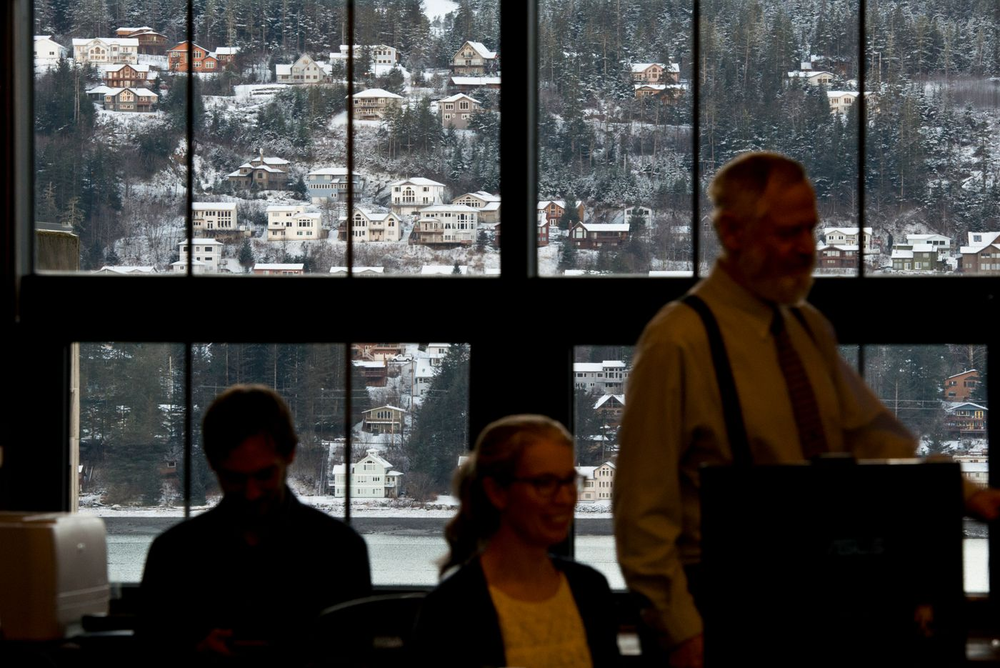 A dusting of new snow on the neighboring island of Douglas is visible from the House Finance Committee meeting room in the Capitol.