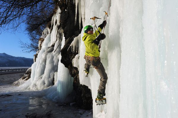 Alex Spoonde begins ascending a wall of ice known to ice climbers as Waterworld located in a pull out along the Seward Highway on Sunday, Jan. 8, 2017. (Bill Roth / Alaska Dispatch News)