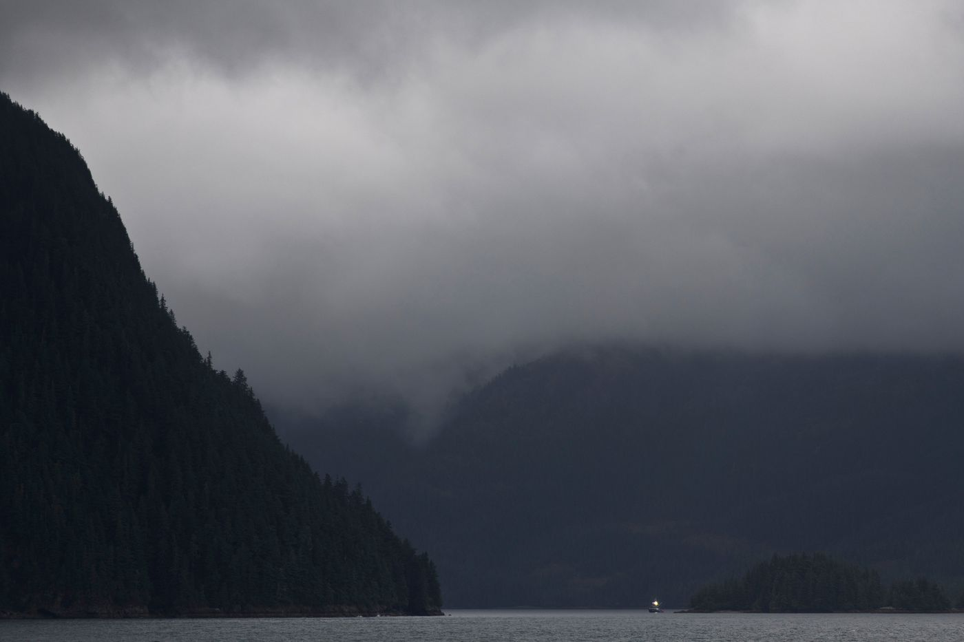 A light from a commercial fishing boat is seen from the Alaska Marine Highway ferry Aurora on Prince William Sound. (Marc Lester / ADN)