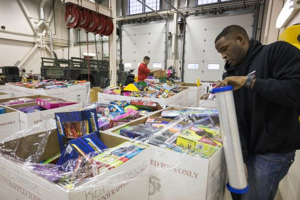Marine Corps Staff Sgt Julius Howard wraps pallets of toys at the Col. Archie T. Van Winkle Marine Corps Reserve Training Facility on Joint Base Elmendorf-Richardson Wednesday, Nov. 15, 2017. The Marine Corps Toys for Tots program is distributing over 4,000 toys to rural communities in Alaska. (Loren Holmes / Alaska Dispatch News)