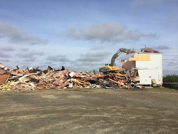 Demolition work on the building that housed the state Office of Children's Services in Bethel continues on June 22. The building suffered interior damage while being leveled in Oct. 2016. (Lisa Demer / Alaska Dispatch News)