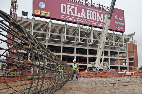 In this Oct. 1, 2015 photo, Jose Bautista works on a rebar support for new footings as renovations continue at the University of Oklahoma's football stadium in Norman, Okla. Tumbling crude prices in oil-rich states are pinching off the largesse that helps universities when state budgets are strained. Oklahoma has scaled back a planned $370 million renovation to its football stadium.