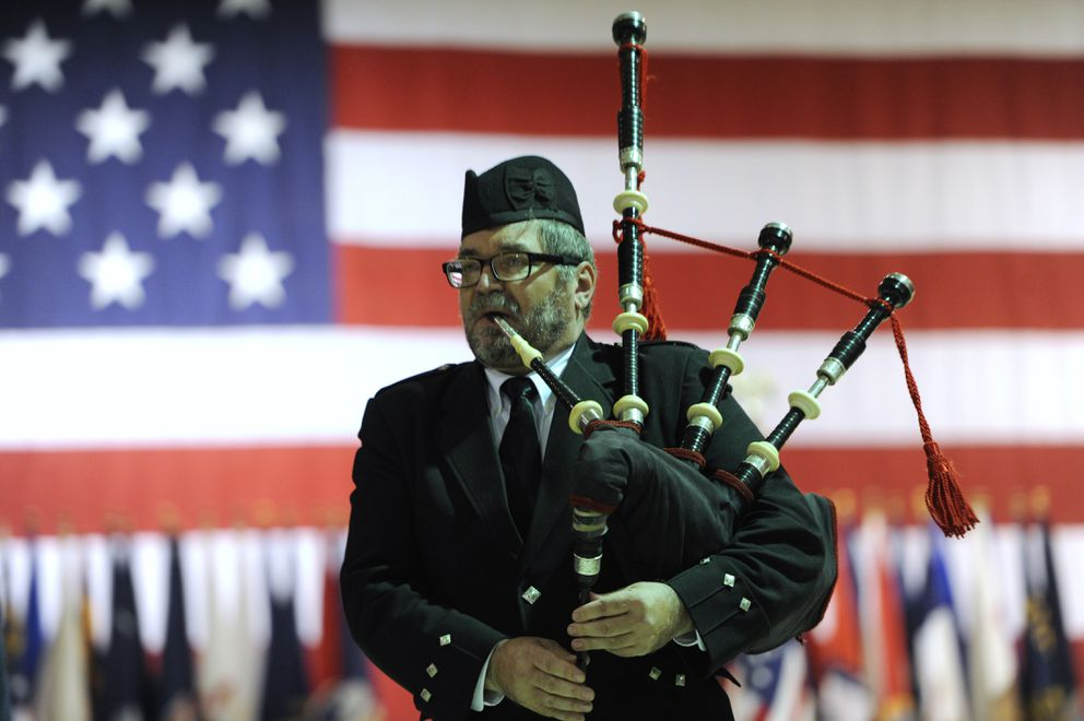 Ian White with the Crow Creek Pipes and Drums played the bagpipes during the Veterans Day ceremony. (Bill Roth / ADN)