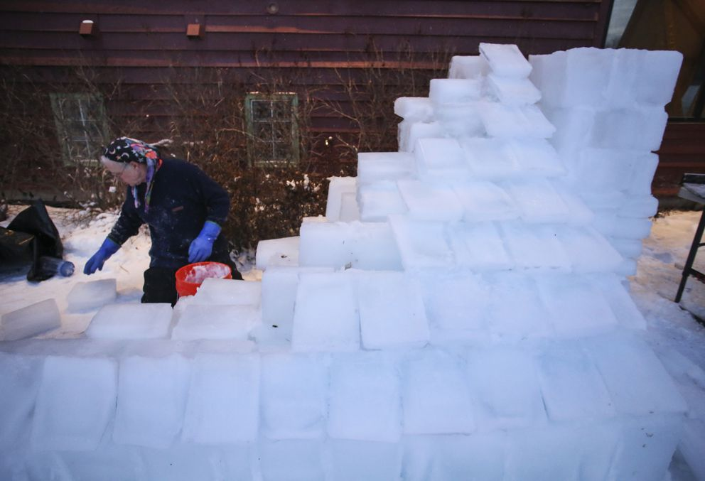 Tommy O'Malley constructs the roof of an ice sculpture on Friday, Dec. 4, 2020. (Emily Mesner / ADN)