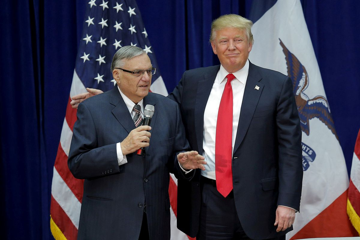 Then-Republican presidential candidate Donald Trump is joined by Maricopa County Sheriff Joe Arpaio at a campaign rally in Marshalltown, Iowa, on Jan. 26, 2016. (Brian Snyder / Reuters file)
