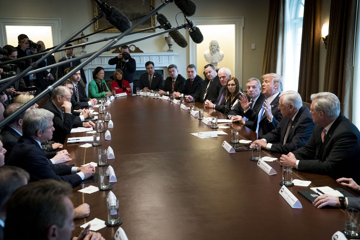 President Donald Trump with lawmakers during a bipartisan meeting on immigration in the Cabinet Room of the White House in Washington, Jan. 9, 2018. (Doug Mills/The New York Times)