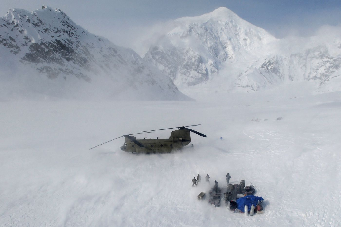 Wind from a landing CH-47 Chinook helicopter kicks up snow as soldiers with B Company,1st Battalion, 52nd Aviation Regiment from Fort Wainwright assist the National Park Service by airlifting supplies from Talkeetna to the base camp being established for the upcoming climbing season at the 7,200-foot level of Denali, the tallest mountain in North American. They landed on the southeast fork of the Kahiltna Glacier last April. (Bill Roth / Alaska Dispatch News)