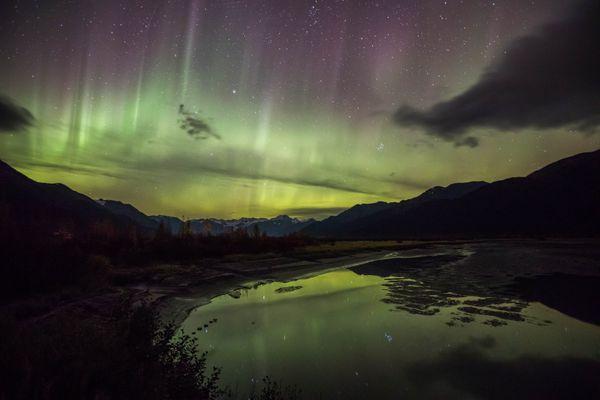 The northern lights make an appearance above Twentymile River along Turnagain Arm on Wednesday night, Sept. 28, 2016. (Loren Holmes / Alaska Dispatch News)