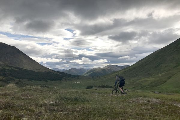 A biker descends from Resurrection Pass, soon to pass the Devil's Pass cabin and then down to the Cooper Landing side of the Resurrection Trail, July 1, 2017. (Anne Raup / ADN)