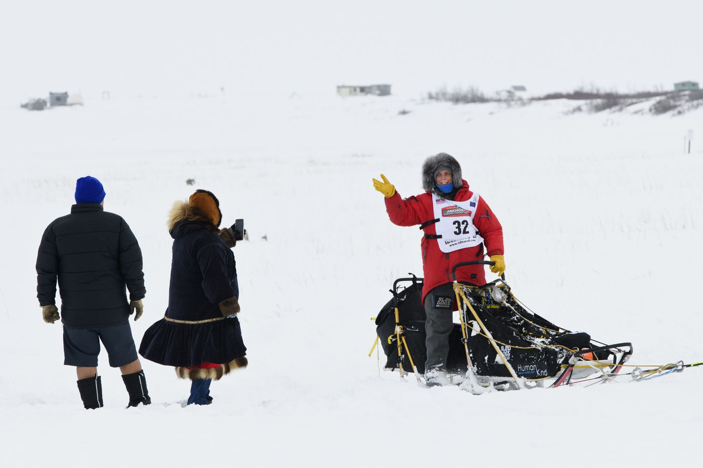 Mille Porsild waves to people as she approaches Nome. Porsild was the first Iditarod Trail Sled Dog Race rookie to finish. She arrived in 15th place on March 18, 2020. (Marc Lester / ADN)