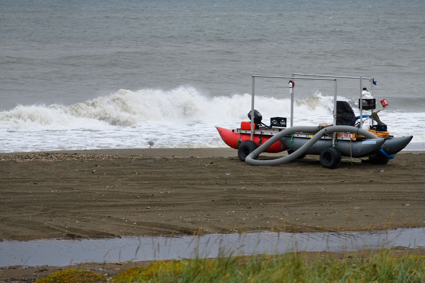 A suction dredge is parked on the beach near Nome. (Marc Lester / ADN)