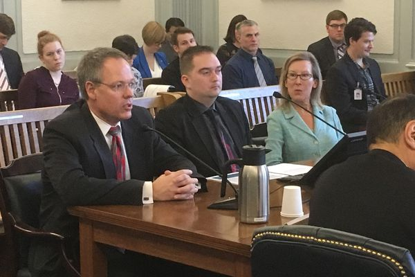 From left to right, Department of Revenue Commissioner Bruce Tangeman, Office of Management and Budget economist Ed King, and Office of Management and Budget director Donna Arduin testify Wednesday, March 6, 2019 in the Senate Finance Committee. (James Brooks / ADN)