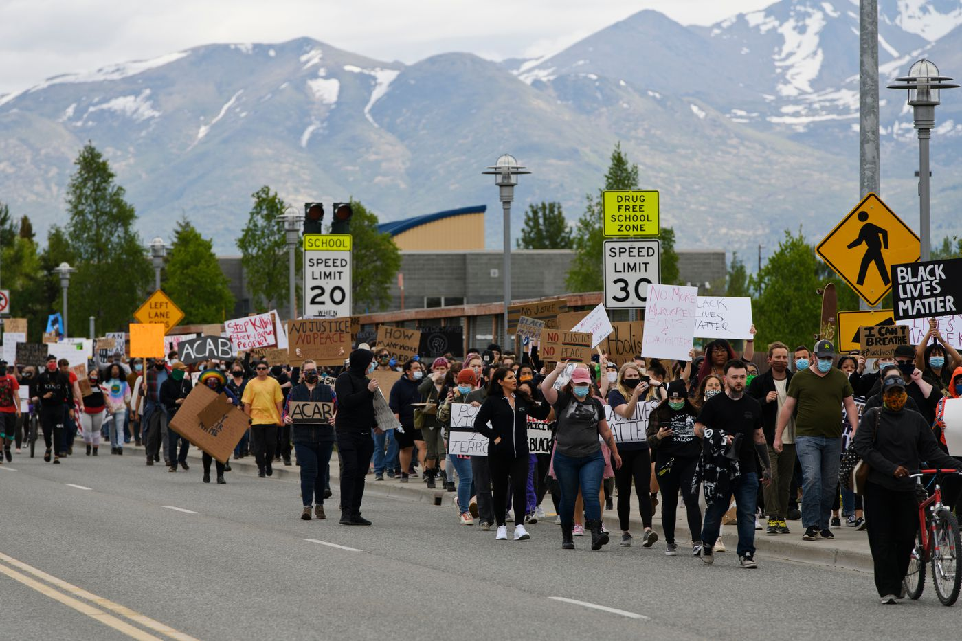 Marchers approach the Delaney Park Strip Saturday afternoon. (Marc Lester / Anchorage Daily News)