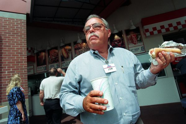 Jim Sinegal, co-founder and former CEO of Costco, with one of the retail giant's signature deals, a hot dog and drink for $1.50, in June 1997. (Rod Mar/Seattle Times/TNS)