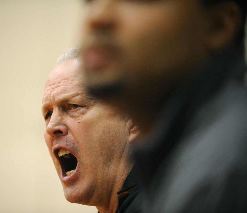 West boys basketball coach Chuck White hollers in from his bench. West defeated Bartlett in the second round of the Alaska Airlines Classic on Saturday, January 17, 2009. (Marc Lester / Anchorage Daily News)
