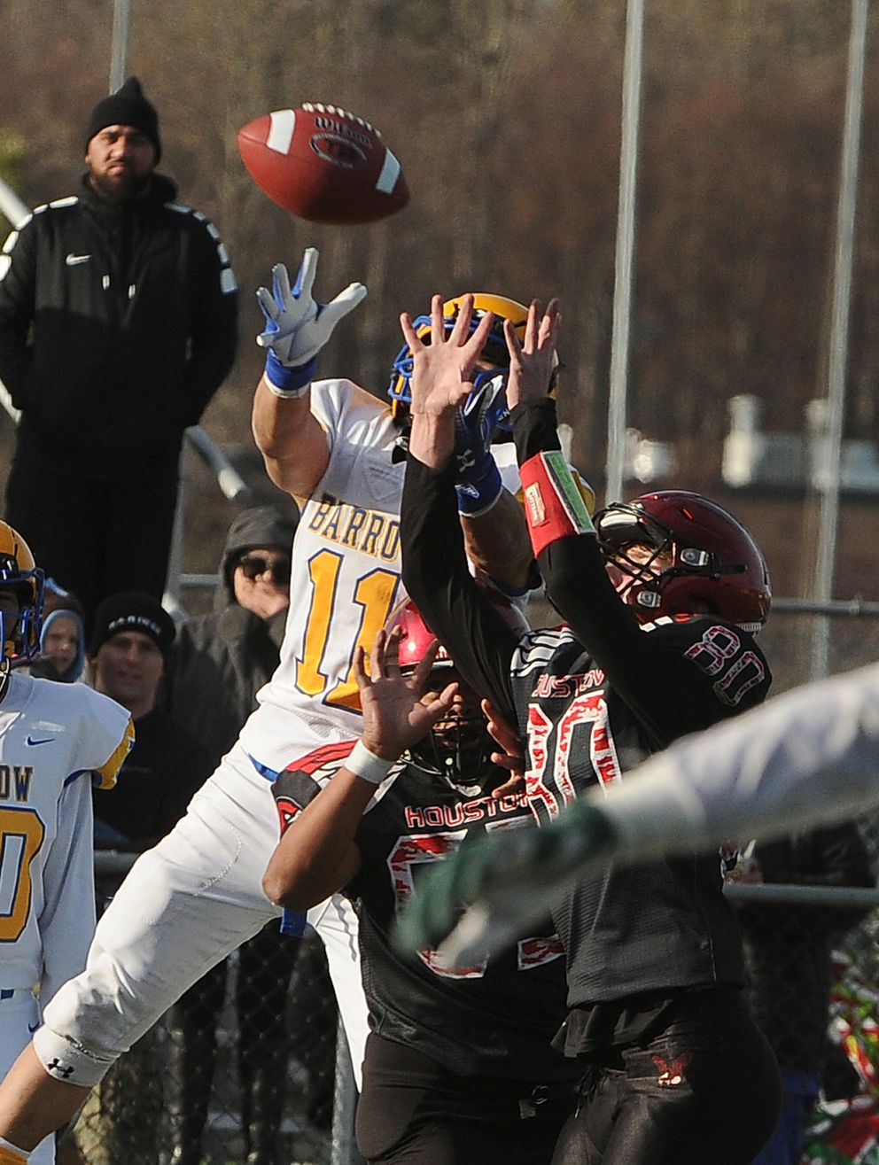 Ervin Felt, of Barrow, and Brain Fialelei and Gavin Mulhaney, of Houston, go up for a pass at Anchorage Football Stadium in Anchorage, AK on Saturday, October 19, 2019. Houston defeated Barrow 41-8 to win the Division III Alaska State Championship game. (Bob Hallinen photo)