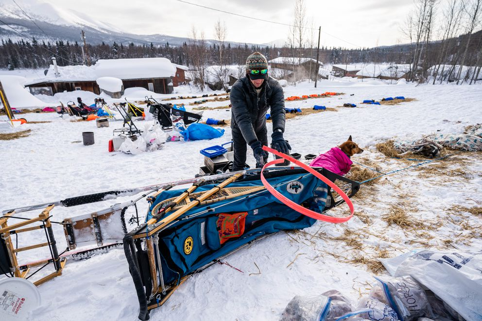 Matthew Failor replaces the runners on his sled in Takotna on Wednesday, March 11, 2020 during the Iditarod Trail Sled Dog Race. (Loren Holmes / ADN)